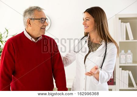 Senior man on consultation with doctor, close up