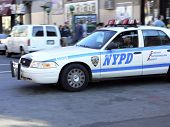stock photo of nypd  - nypd police car rolls down Bedford Ave - JPG
