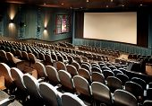 stock photo of movie theater  - Nice clean shot of a new movie theater with blank screen for type