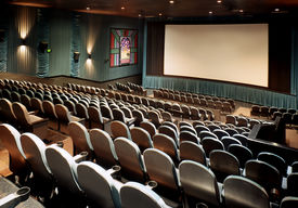 image of movie theater  - Nice clean shot of a new movie theater with blank screen for type  - JPG