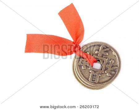 Three chinese coins of luck tied with red ribbon symbolizing prosperity and fortune - shot over white background