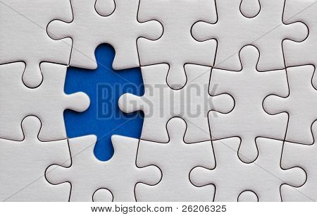 Jigsaw puzzle with one piece missing