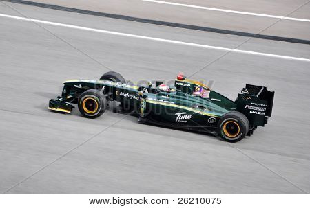 SEPANG, MALAYSIA - APRIL 4 : Heikki Kovalainen of Team Lotus at top speed during Malaysian Formula 1 Grand Prix at Sepang F1 circuit April 4, 2010 in Sepang, Malaysia