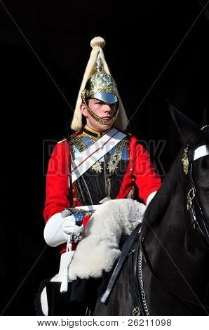 LONDON – SEPTEMBER 24: An unidentified Royal Guard on horse is on guard at the Admiralty House on September 24, 2011 in London, England.  Two mounted guards are posted every day from 10 a.m. to 4 p.m. and are relieved every hour.