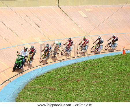 KUALA LUMPUR - NOVEMBER 13: Unidentified riders participates in Kuala Lumpur International Fixed Gear Tournament 2011 at the Kuala Lumpur Velodrome on November 13, 2011 in Kuala Lumpur, Malaysia.