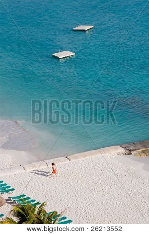 People on vacation on the beach at a resort hotel in cancun mexico