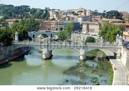 Pont di San Angelo (Bridge of St. Angelo) in Rome crossing the tevere (tiber) river with cars and people