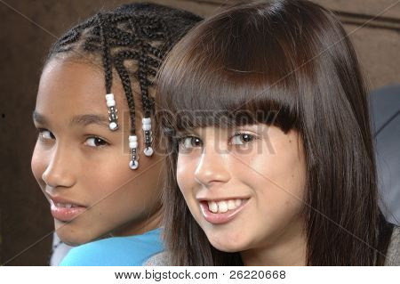 cute african american girl with caucasian girl friend