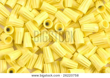 Yellow wirenuts used for connecting 12 gauge wire in household circuits as a background