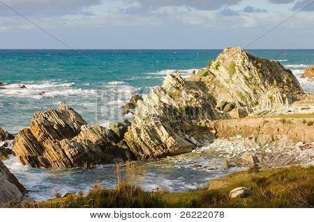 Stratified coastal rock formations in the Waiarapa region of New Zealand