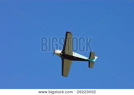 generic low wing general aviation aircraft overhead
