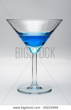 Martini glass filled with blue liquid