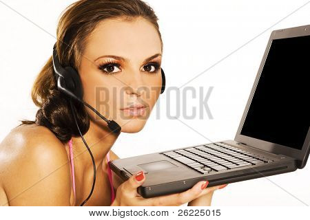 beautiful woman wearing bikini with a laptop and headphones with mic