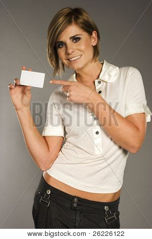 beautiful smiling woman holding a membership card bank card or credit card