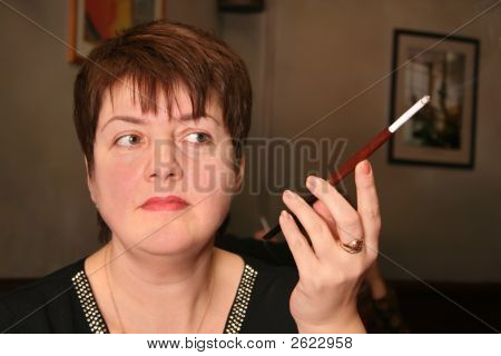 Woman With Cigarette In Mouthpiece