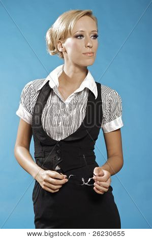 beautiful blonde businness woman portrait, holding a glasses.