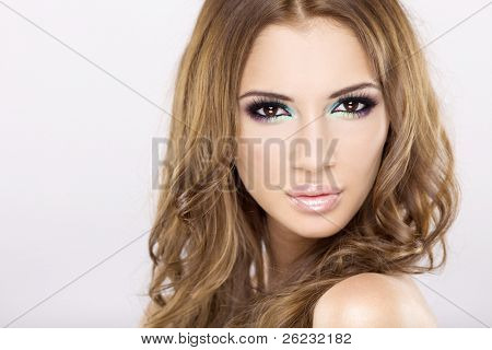 portrait of a beautiful adult sensuality brunette woman in multicolor makeup isolated on white background