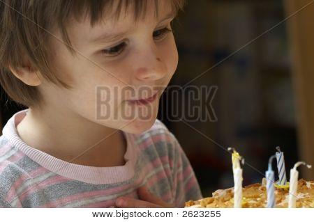 Boy Blow Out Celebratory Candles