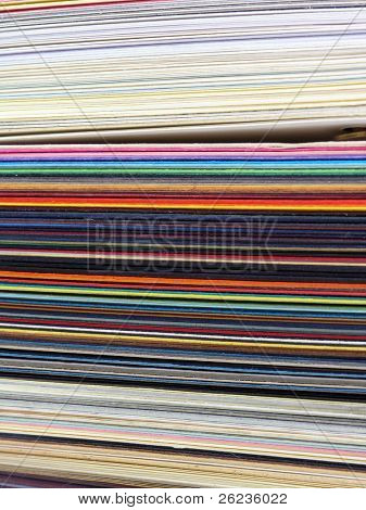 Colored samples of different papers on white background