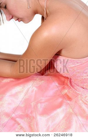 young woman in beautiful peach formal for prom or bridal applications