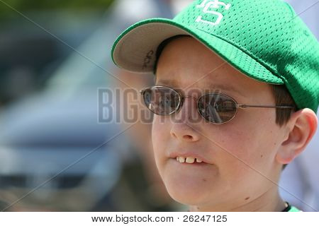Anxious baseball player bites his lip while waiting to go to bat