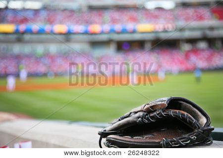 Baseball glove on the wall with a major league stadium in the background