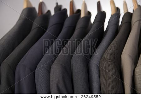 Men's suits hanging on a rack