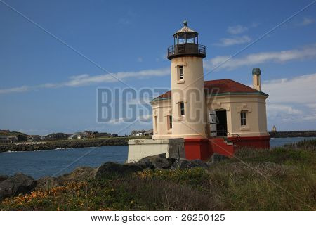 Coquille River Lighthouse in Bandon Oregon with the river in the background