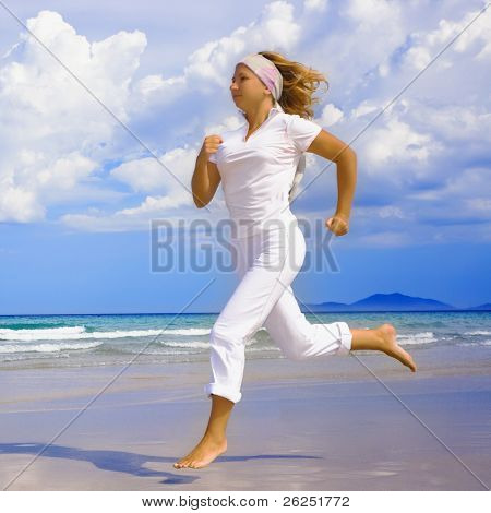 Young woman jogging near the ocean