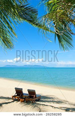 Chairs On The Beach Near Sea