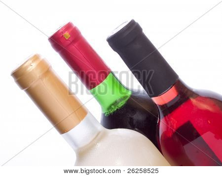 tree multicolored sweet red and white wine bottles isolated on white