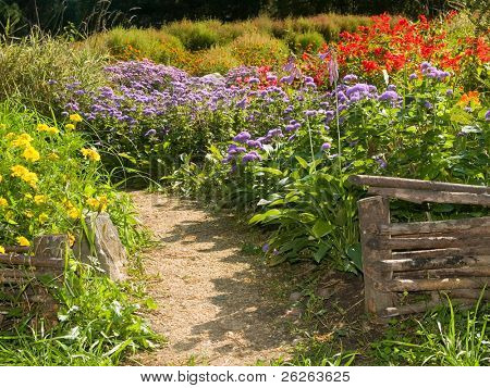 Beautiful flowerbed behind rural retro fences