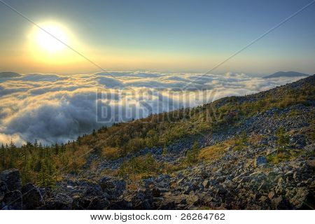 HDR image of majestic sunset of the Russian Primorye mountains landscape