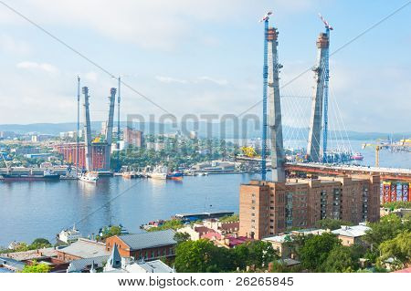 construction of big guyed bridge in the Russian Vladivostok over the Golden Horn bay
