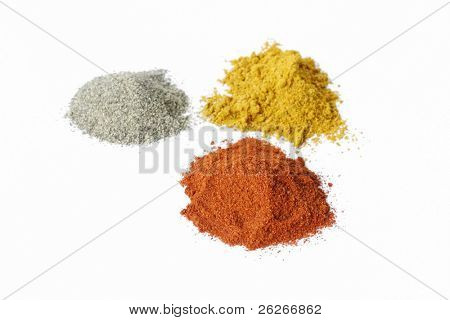 three piles of spices