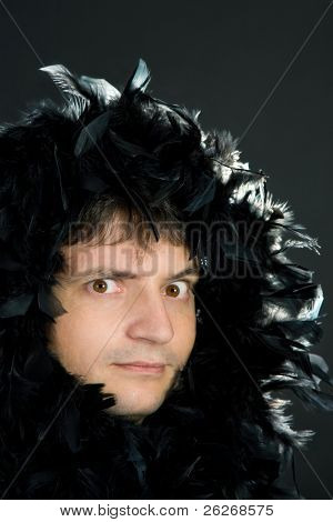 man in black feather boa