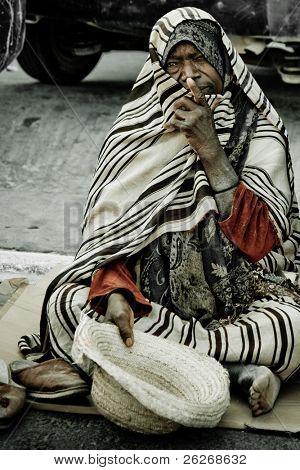 MIDOUN, TUNISIA - JUNE 16: Homeless man begs on the street on June 16, 2009 in Midoun, Djerba, Tunisia