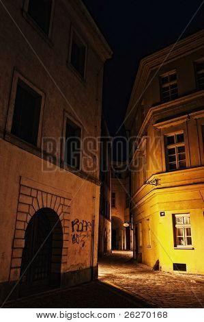 illuminated mysterious narrow alley at night in Prague