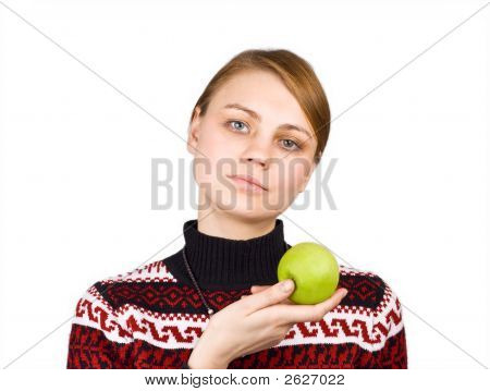 Beautiful Young Girl Holding A Healthy Looking Green Apple. Isolated On White Background.