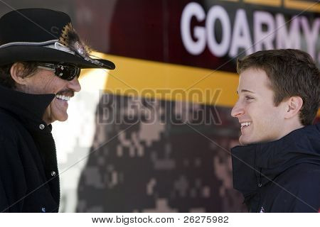 HAMPTON, GA - MAR 5:  Richard Petty and Kasey Kahne talk before practice for the Kobalt Tools 500 at Atlanta Motor Speedway on Mar 5, 2010 in Hampton, Georgia