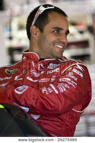 HAMPTON, GA - MAR 5: Juan Pablo Montoya gets in his car during practice for the Kobalt Tools 500 at Atlanta Motor Speedway on Mar 5, 2010 in Hampton, Georgia