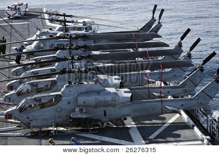 SAN DIEGO, CA - MAY 28:  U.S. Marine Corps Huey and Cobra Helicopters sit onboard the USS Peleliu as they begin workup manuevers for their upcoming deployment on May 28, 2010 near San Diego, CA.