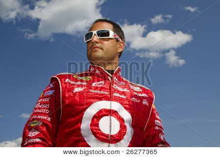 LOUDON, NH - JUNE 25:  Juan Pablo Montoya gets out of his car after qualifying for the LENOX Tools 301 race at the New Hampshire Motor Speedway in Loudon, NH on June 25, 2010