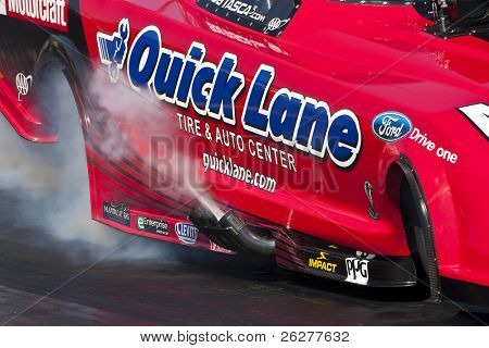 CONCORD, NC - MAR 27:  Robert Tasca III brings his Quicklane Ford Mustang down the track at the zMax Dragway for the running of the inaugural Four-Wide Nationals event in Concord, NC on Mar 27, 2010