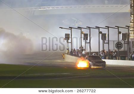 HAMPTON, GA - SEP 05:  Scott Speed pulls his Toyota down pit road after his engine catches on fire at the Emory Healthcare 500 race at the Atlanta Motor Speedway in Hampton, GA on Sep 05, 2010.