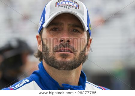 LOUDON, NH - SEP 17:  Jimmie Johnson wathces the scoring pylon as he waits to qualify for the Sylvania 300 race at the New Hampshire Motor Speedway in Loudon, NH on Sept 17, 2010.