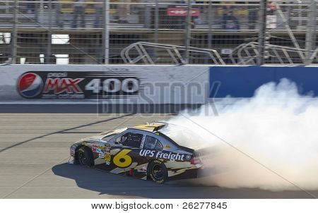 FONTANA, CA - OCT 10:  David Ragan spins off the frontstretch during the Pepsi Max 400 race at the Auto Club Speedway in Fontana, CA on Oct 10, 2010.