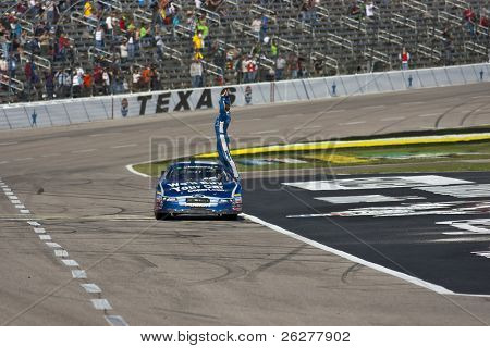 FORT WORTH, TX - NOV 06:  Carl Edwards holds off Kyle Busch and the rest of the field to win the O'Reilly Auto Parts Challenge race on NOV 6, 2010 at the Texas Motor Speedway in Fort Worth, TX.