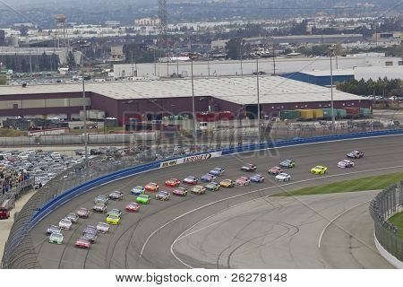 FONTANA, CA - MAR 27:  The NASCAR Sprint Cup Series teams take to the track for the Auto Club 400 race at the Auto Club Speedway in Fontana, CA on Mar 27, 2011.
