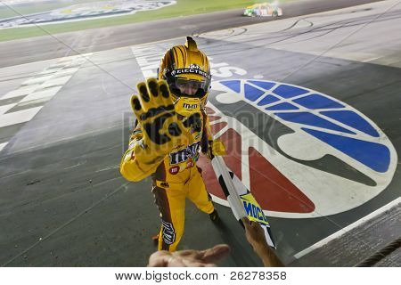 SPARTA, KY - JULY 09:  Kyle Busch (18) wins the Quaker State 400 race at the Kentucky Speedway in Sparta, KY on July 09, 2011.